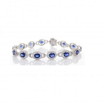 5104-9-04-carat-total-oval-blue-sapphire-and-diamond-bracelet-in-18-karat-white-gold